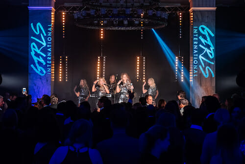 Girls International on stage at The Celtic Manor, Newport, a great corporate business event venue