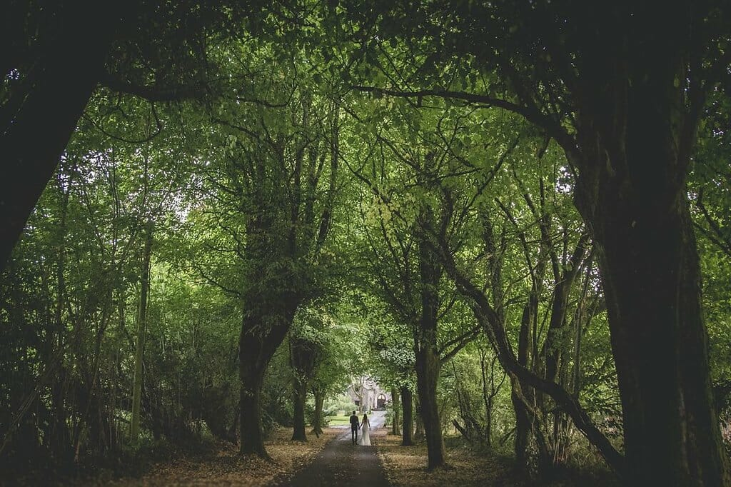 bride and groom walking to their wedding venue