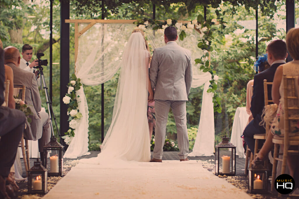 Bride and Groom down the aisle at Fairyhill