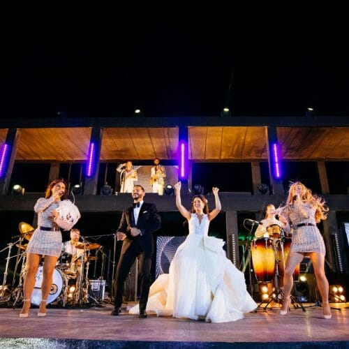 bride and groom on stage with wedding band big day showband
